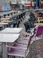 panoramic view of a street cafe with empty chairs