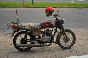 Old Motorcycle and red helmet