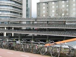 bicycles in a parking lot in amsterdam