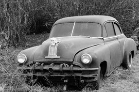 black and white photo of a car