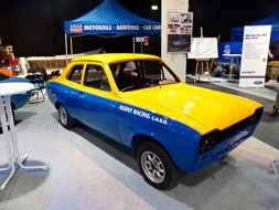 old yellow blue racing machine