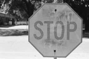 black and white photo of a stop road sign