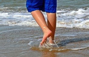 feet in the surf water