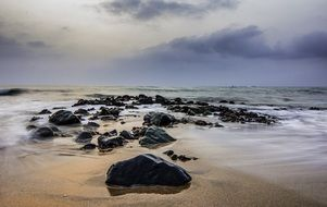 Seascape with the rocks on the beach