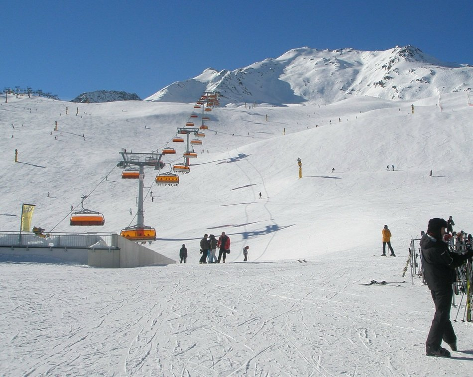 panoramic view of the ski lift and ski run on a sunny day