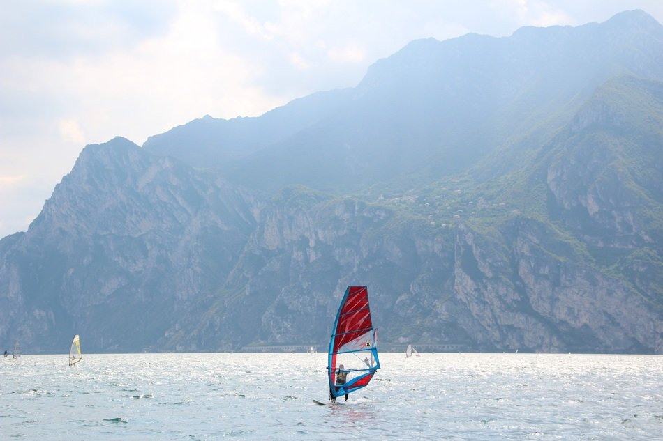 surfing on garda lake on a cloudy day