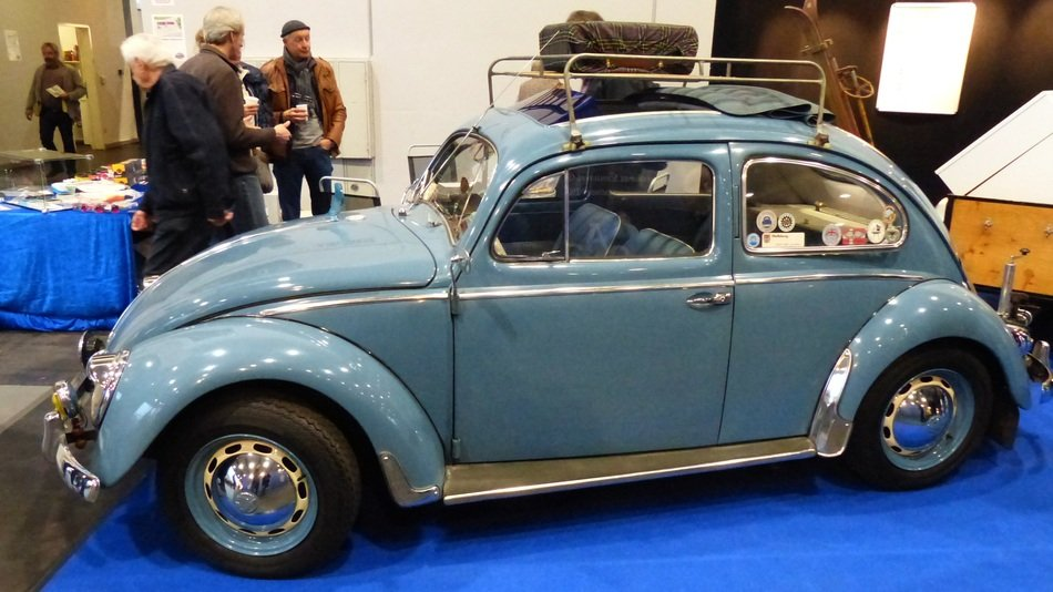 blue Volkswagen beetle on a exhibition