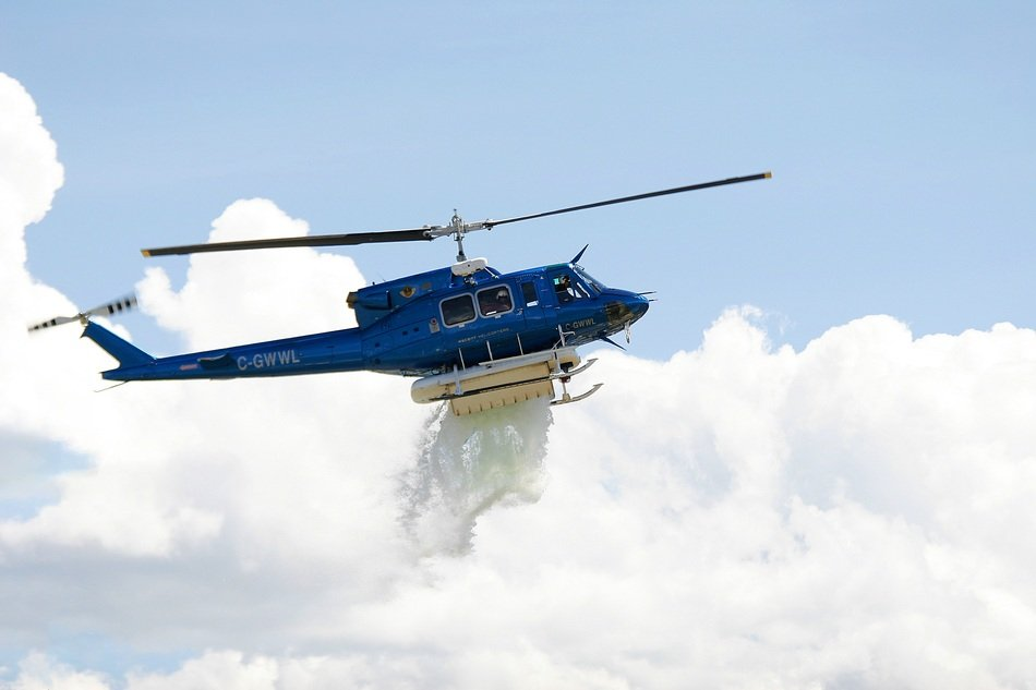 blue rescue helicopter dumps water
