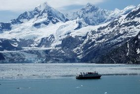 cruise ship is sailing along glaciers in alaska