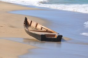 wooden boat on a sandy beach in puerto rico