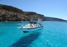 yacht is moored off the coast of the island of Lampedusa