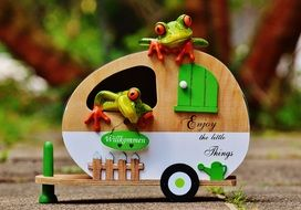 green frogs in a cart