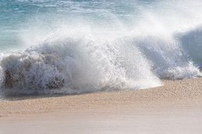 splash from the waves on a sandy beach in Cape Verde