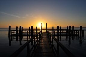 wooden pier on sea at Sunrise, germany, nordfriesland