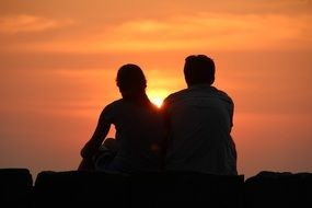 couple in the rays of a bright sunset