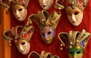 carnival masks on the wall in venice