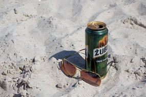 Sunglasses and Beer on Beach