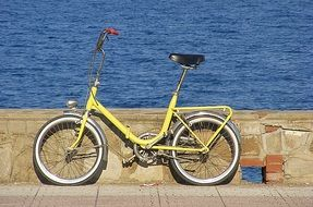 yellow bike on the waterfront
