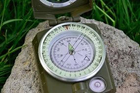 compass on a big stone