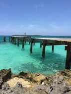 wooden pier over the ocean on the shore of the Bahamas