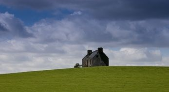 lonely house on a green hill