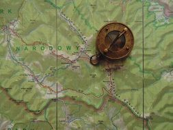 retro compass on the map
