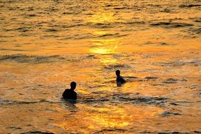 bathers at sunset