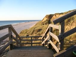 wooden stairway at Red Cliff, rusty-red glacial till on Beach of North Sea, germany, Sylt