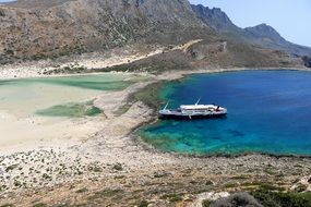 panoramic view of a ship in a bay in crete