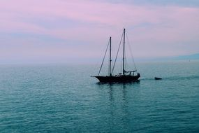 sailing boat in a calm sea on the coast of Italy