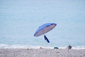beach umbrella on the pebble beach