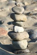 stones sculpture on the beach