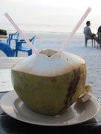 cocktail in a coconut on the beach in Langkawi