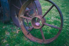 easter egg on a rusty wheel