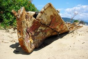 old broken wooden boat on a tropical beach