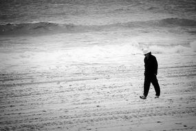lonely man on a grey beach
