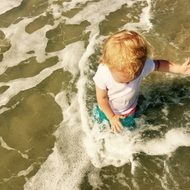 Kid splashing on sea