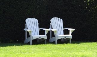white chairs in a green meadow