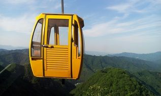 Ropeway Yellow Distant Hills
