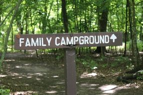 sign in the woods for camping