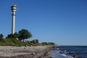 high lighthouse on the coast of the baltic sea