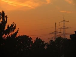 transmission pylons at sunset