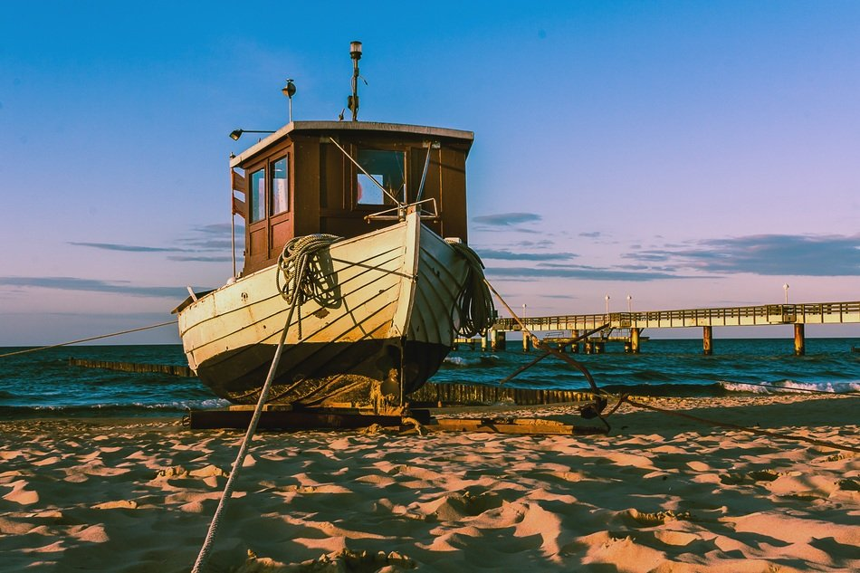 fishing boat on a sandy beach on the Baltic Sea