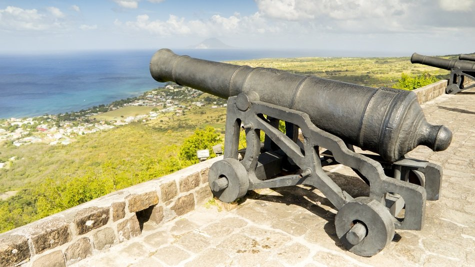 ancient cannon in a fortress on the coast of the sea