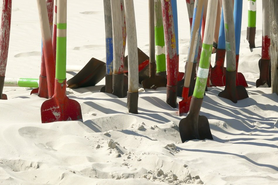 lot of colorful shovels in Sand on Beach