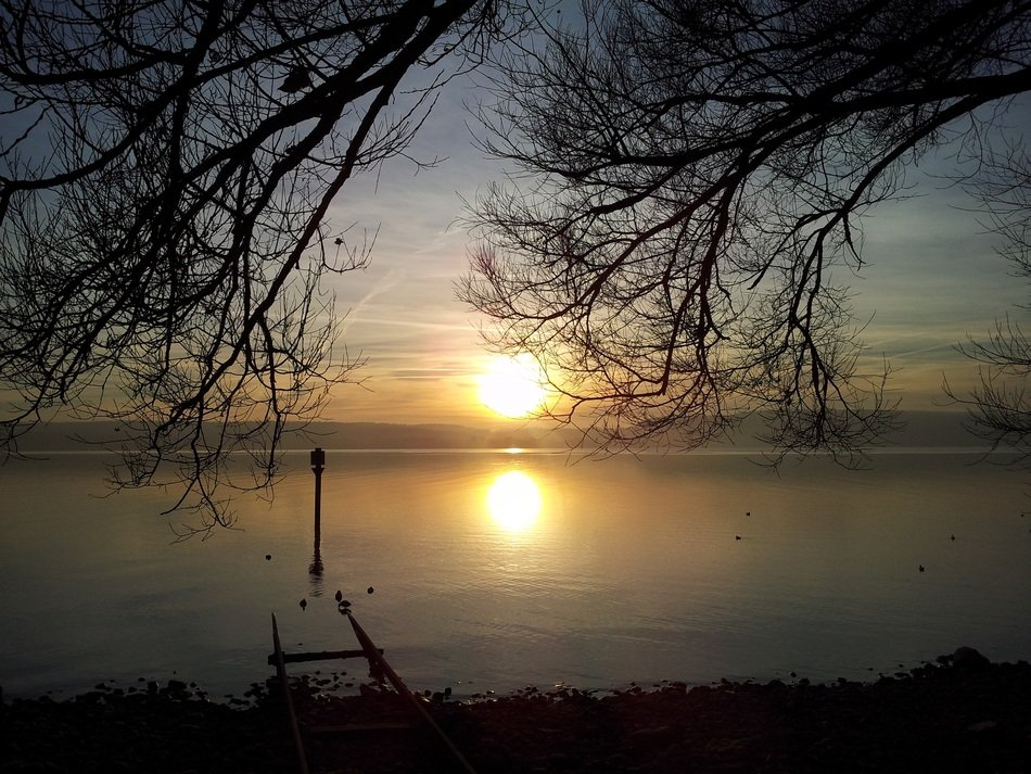 bright sunset over lake constance