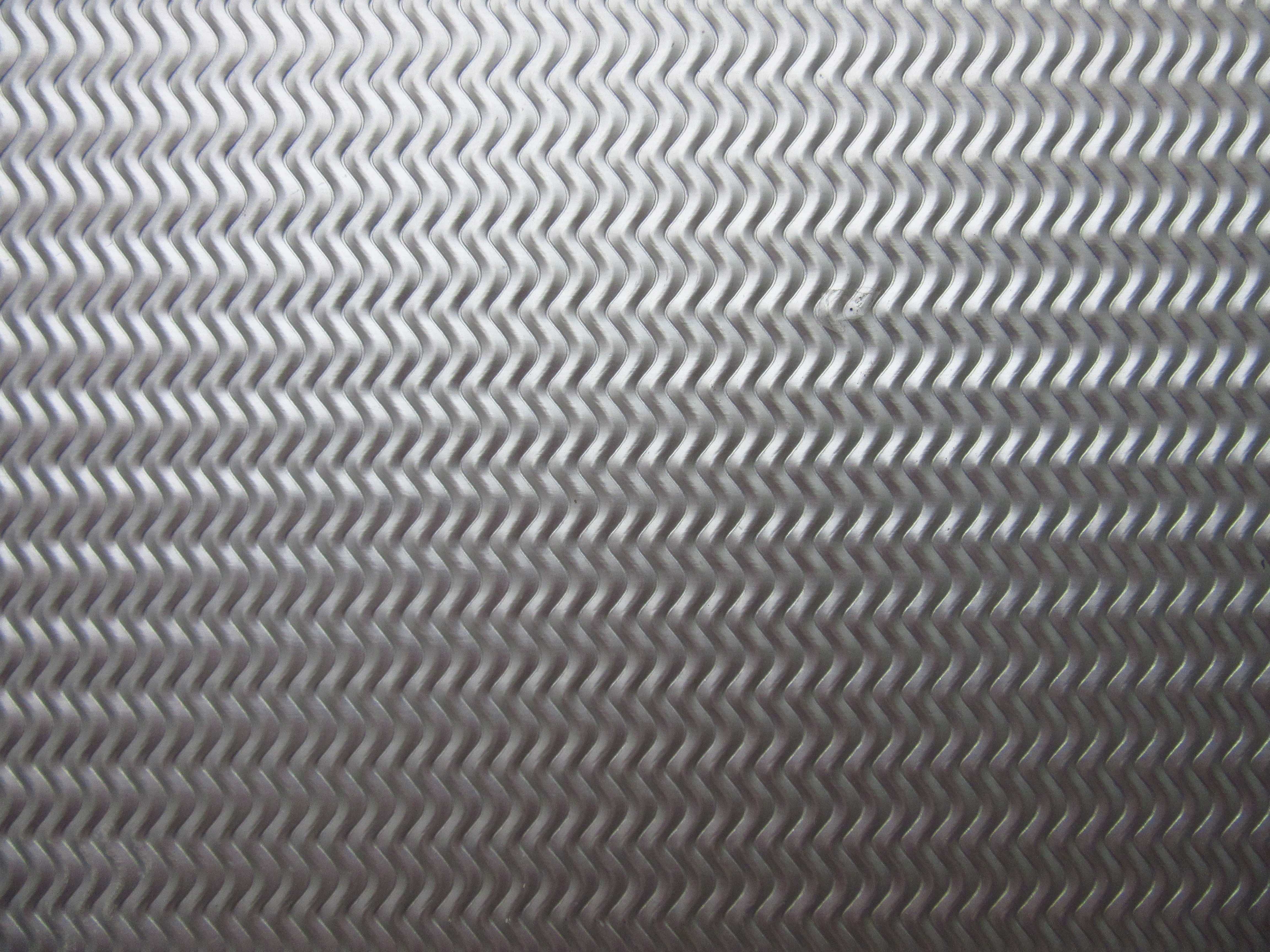 Sheet rip shiny metal embossed grey color background free