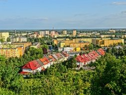 panoramic view of residential buildings among green trees