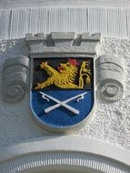 coat of arms on a white wall