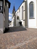 city church on a narrow street in Zofingen